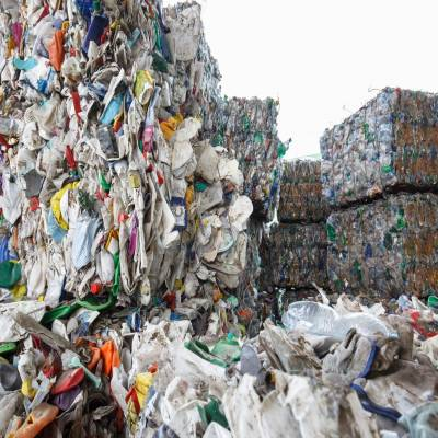 How can the construction industry support plastic ban by reusing plastic waste?